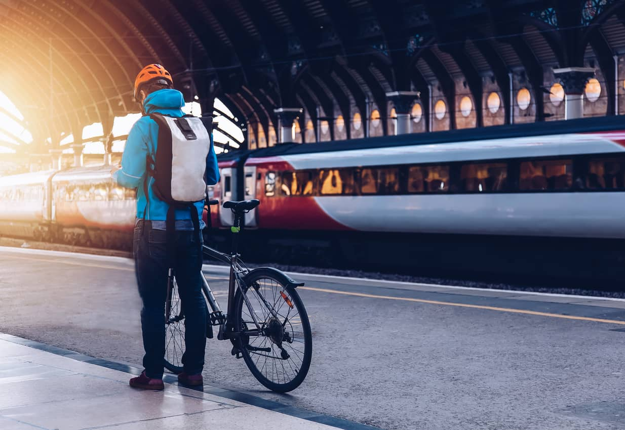 an image of a commuter at a train station